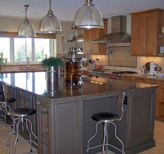 Deer Lake Renovation Kitchen with large work island and custom cabinetry.
